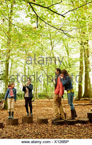 Beech woods in Autumn. A family of four in the woods. - Stock Photo