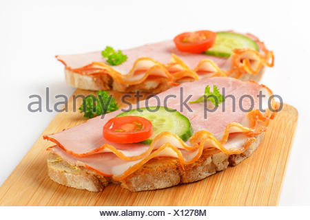 open faced ham sandwiches - Stock Photo