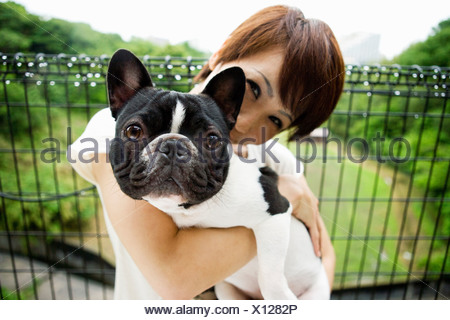 Woman with pet french bulldog - Stock Photo