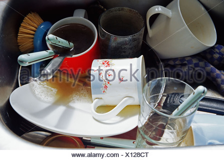 Washing up in a sink - Stock Photo