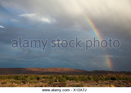 Rainbow on dramatic sky, Augrabies Falls National Park, Northern Cape Province, South Africa - Stock Photo
