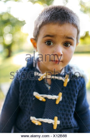 Portrait of little boy with eyes wide open - Stock Photo
