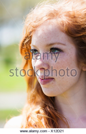 Portrait of a young red haired woman - Stock Photo