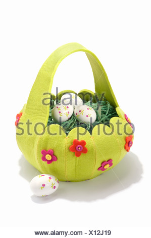 An Easter basket filled with decorated eggs - Stock Photo