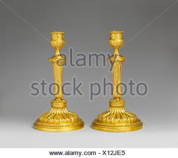 Pair of candlesticks. Date: ca. 1770-75; Culture: French; Medium: Gilt bronze; Dimensions: Overall (confirmed): 10 1/2 x 5 5/8 in. (26.7 x 14.3 cm); - Stock Photo