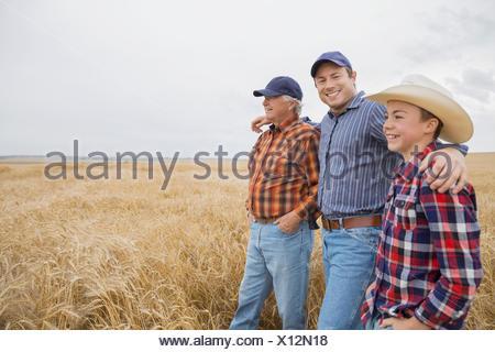 Multi-generation men in wheat field - Stock Photo