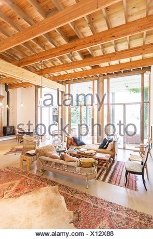 Cottage Sitting Room Coffee Table Beside Armchair In Front Of A Wood Burning Stove In An Exposed