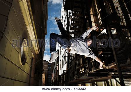 Young man breakdancing - Stock Photo