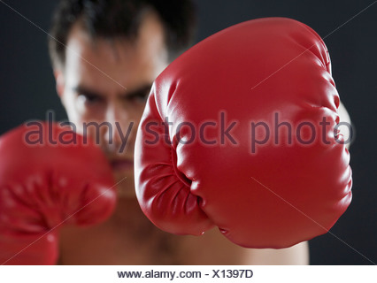 A boxer throwing punches - Stock Photo