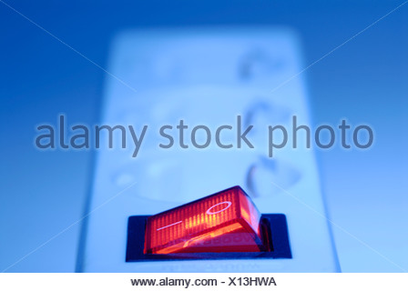 On/off switch on an electrical outlet (socket), power bar - Stock Photo