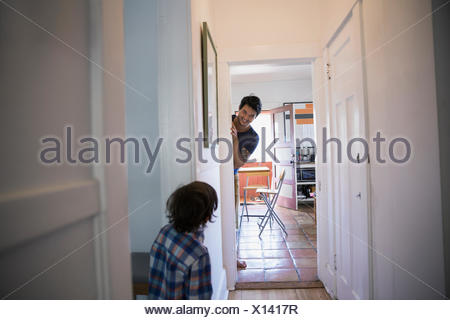 Father and son playing hide and seek - Stock Photo