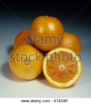 Whole sectioned citrus fruit blood orange variety Doblefina - Stock Photo