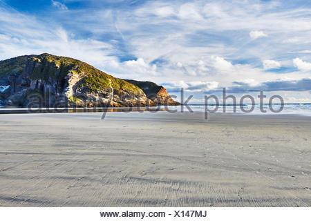 New Zealand, Puponga, Wharariki, rock formations on the beach - Stock Photo