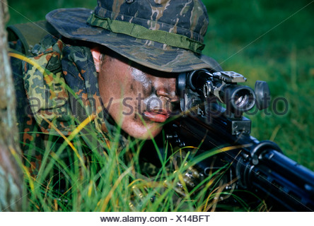 Soldier of the German special forces Kampfschwimmerkompanie in training, sniper with gun G 3 and telescopic sight, camouflage - Stock Photo