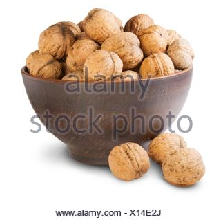 Walnuts In A Clay Bowl Isolated On White Background. - Stock Photo
