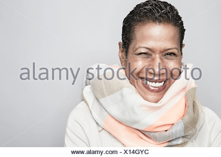 Studio portrait of happy mature woman - Stock Photo