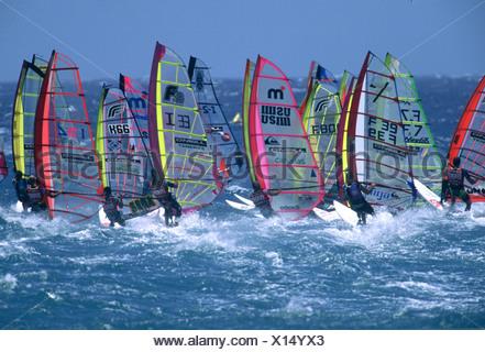 Windsurfers at sea race start, Tenerife - Stock Photo