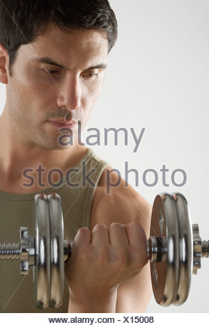 Man using free weights - Stock Photo