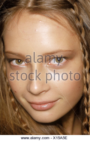 Backstage at Anne Klein New York Ready to Wear Spring Summer Model facing camera smiling long auburn hair two plaits combed - Stock Photo