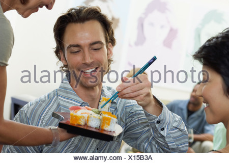 Friends having sushi - Stock Photo