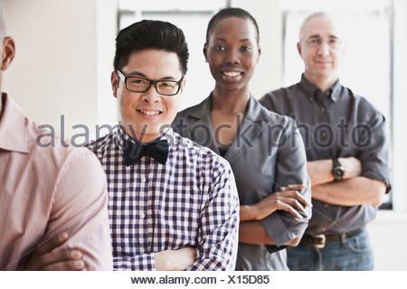Portrait of businesspeople in a line - Stock Photo