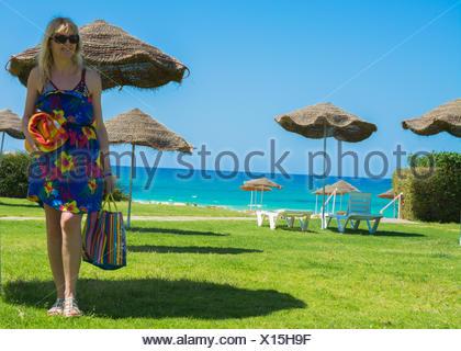 Holidaymaker at Tunisian beach - Stock Photo