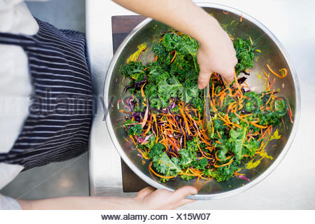 Chef tossing fresh salad - Stock Photo