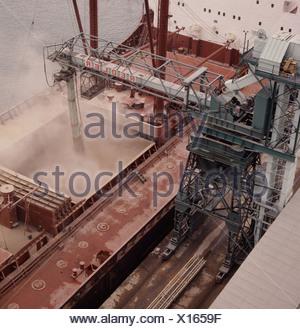 Looking down on a 26000 ton Lebanese grain ship loading its cargo at Southampton Docks - Stock Photo