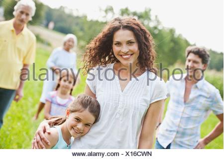 Germany, Bavaria, Family together having picnic, smiling - Stock Photo