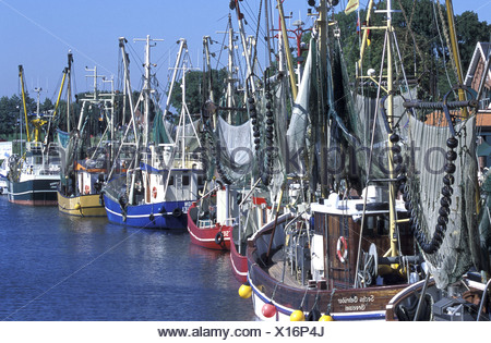 fishing cutters and crab cutters in the harbour of Greetsiel, Germany, Lower Saxony, Greetsiel - Stock Photo