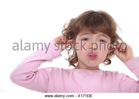 Little girl poking her tongue out - Stock Photo