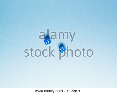 Directly above two blue dice - Stock Photo