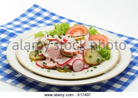 Bavarian sausage salad - Stock Photo