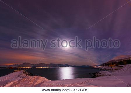 moonlit night at the coast, Norway, Troms, Tromsoe - Stock Photo