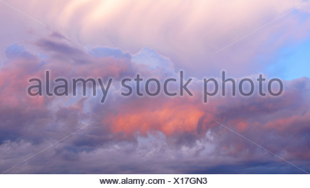 dramatic clouds in the evening glow, Germany, North Rhine-Westphalia - Stock Photo