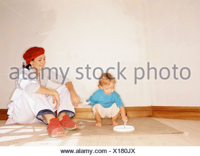 Mother and child in new home - Stock Photo