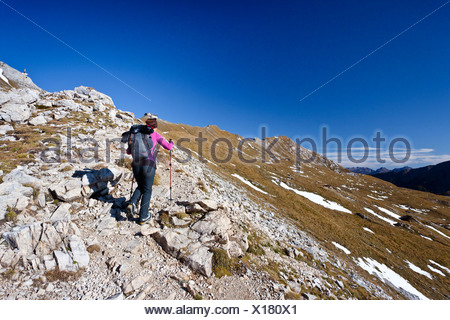 Hiker during the ascent to Bepi Zac climbing route in the San Pellegrino Valley above the San Pellegrino Pass, Dolomites - Stock Photo