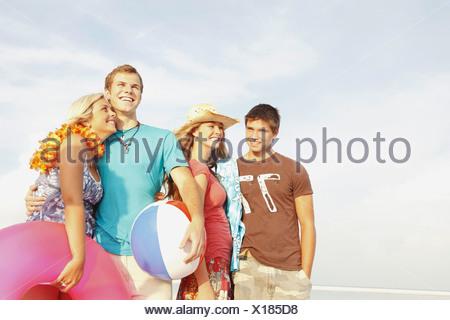 Friends having fun on beach - Stock Photo
