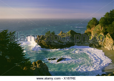 The coastline and a horseshoe bay with waves crashing against the rocks in Julia Pfeiffer Burns State Park. - Stock Photo