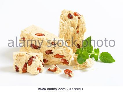 Pieces of Greek halva with almonds - Stock Photo