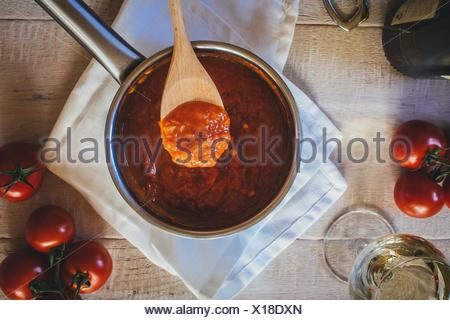 Directly Above Shot Of Tomatoes Gravy In Pan - Stock Photo