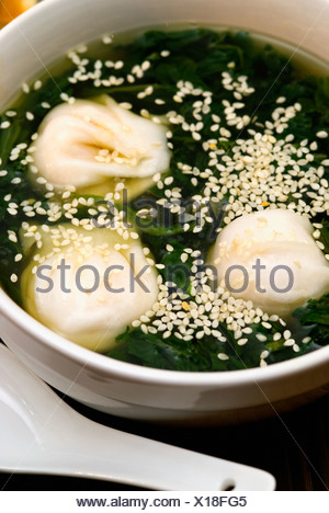 Close-up of Chinese dumplings in a bowl - Stock Photo