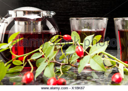 Heisser Hagebuttentee im Glas - Stock Photo