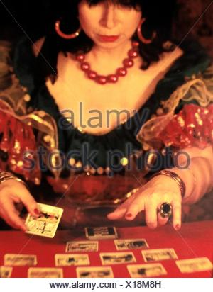 Close-Up Of Woman With Tarot Cards On Table - Stock Photo