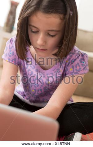 Girl using laptop - Stock Photo