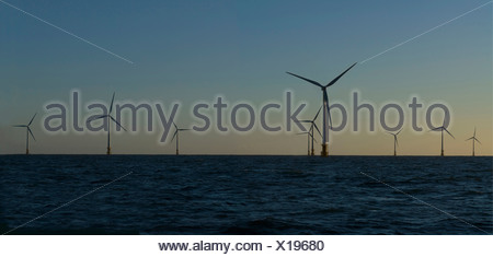 Wind turbines in water against blue sky - Stock Photo