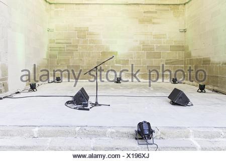 Spotlights and microphone urban concert celebration. - Stock Photo
