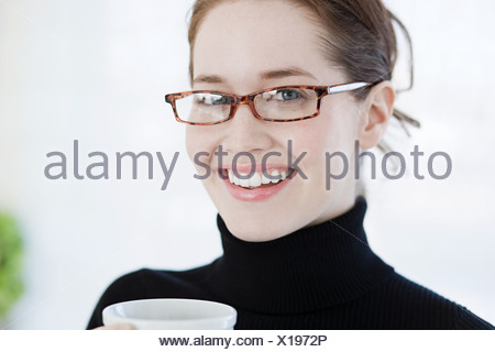Young woman wearing eyeglasses - Stock Photo