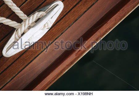 Close-up of rope tied to cleat - Stock Photo