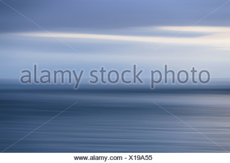 The sea and sky over Puget Sound in Washington USA The horizon with light cloud layers above - Stock Photo